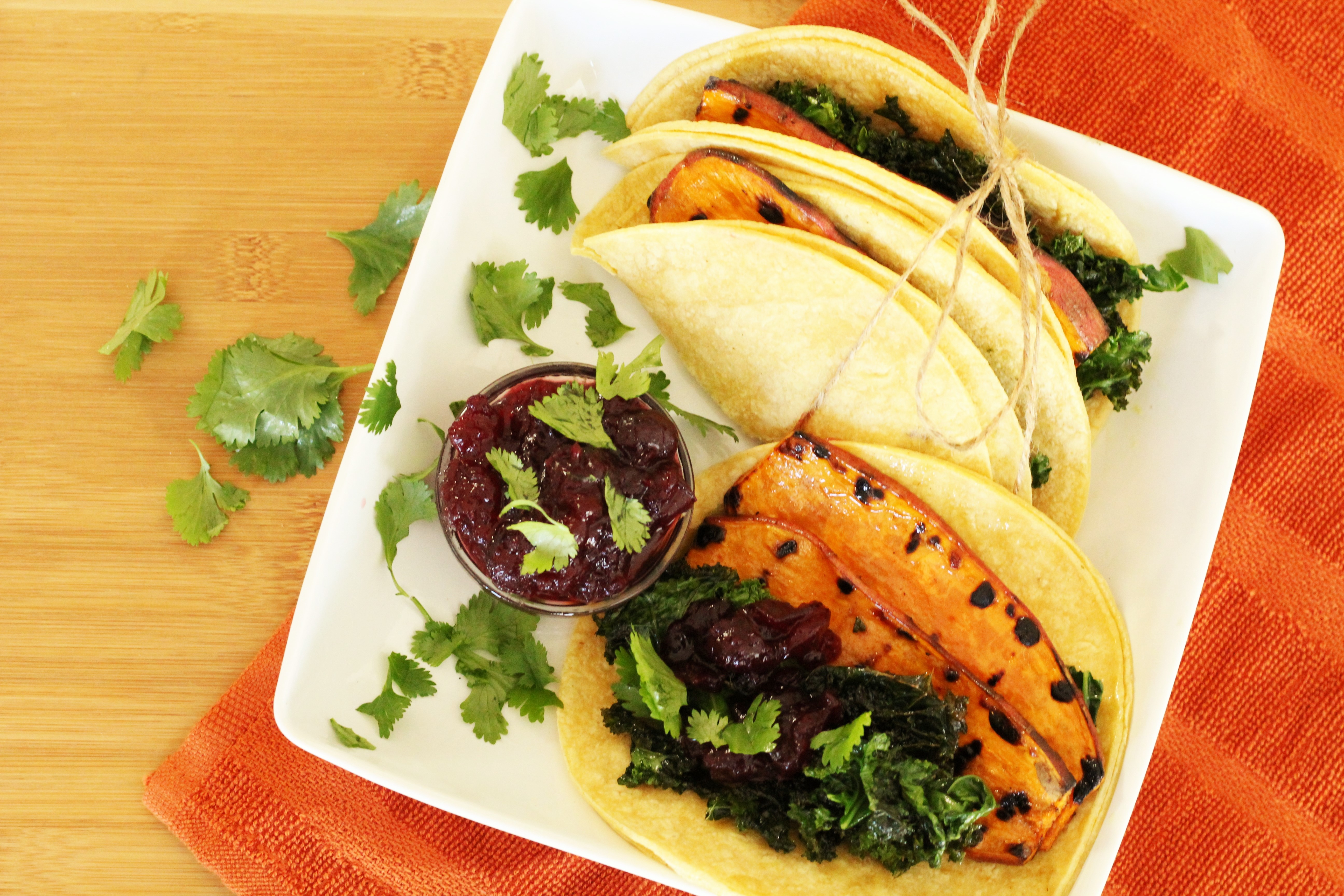 Vegetarian Thanksgiving Tacos - The perfect healthy, plant-based alternative during the holiday times. Sweet potato tacos with sauteed kale, and cranberry cilantro sauce!